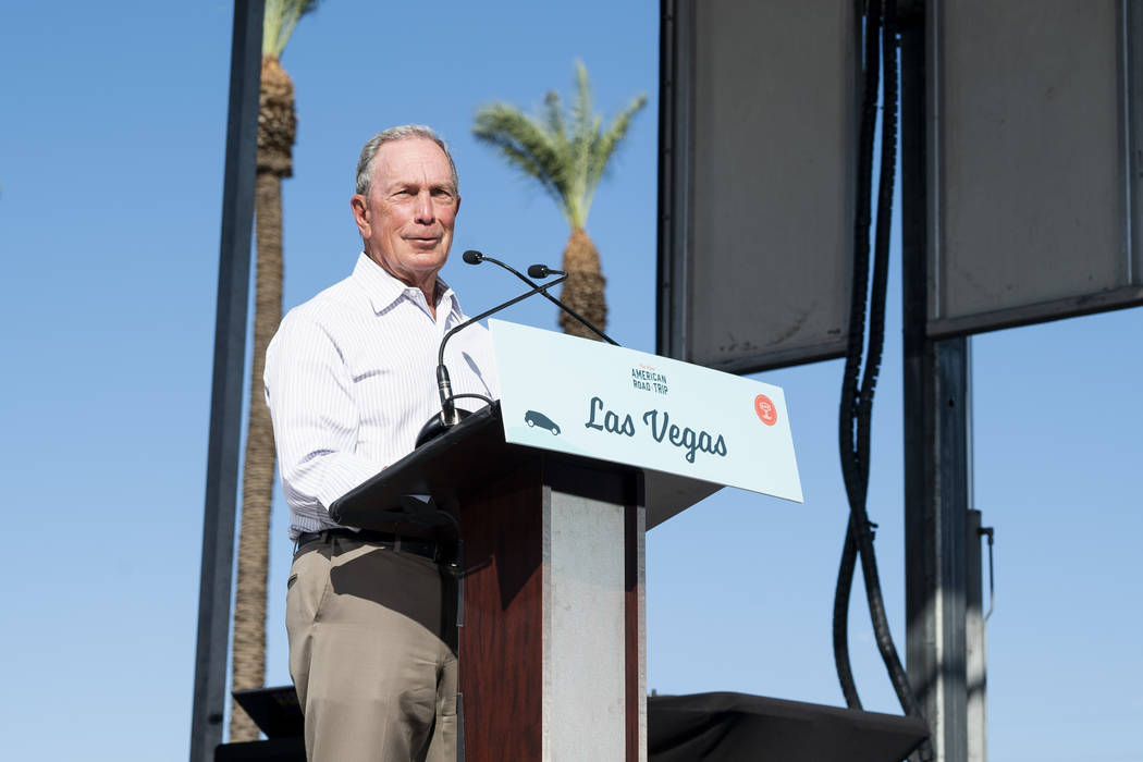 "Former New York City mayor Michael Bloomberg speaks in front of the Luxor hotel-casino in Las Vegas at an event for ""The New American Road Trip,"" an electric-vehicle tour from California to New Yo ..."