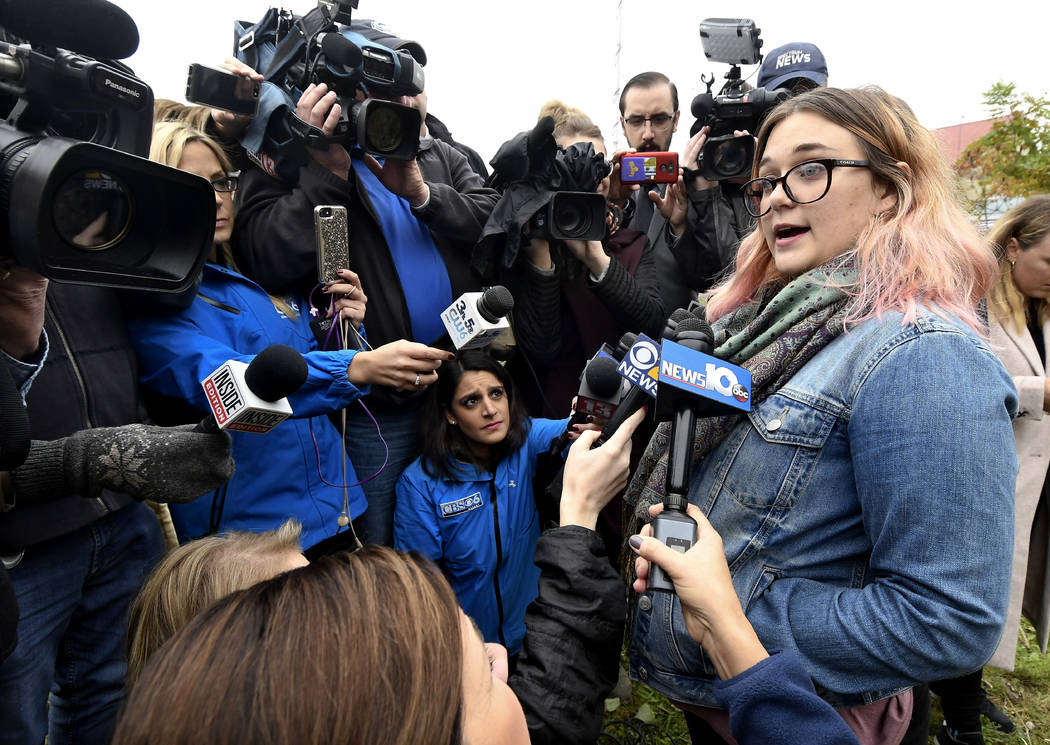 Karina Halse of Fort Ann, N.Y., right, talks to reporters about her sister Amanda Halse who died in Saturday's fatal limousine crash in Schoharie, N.Y., Monday, Oct. 8, 2018. A limousine loaded wi ...