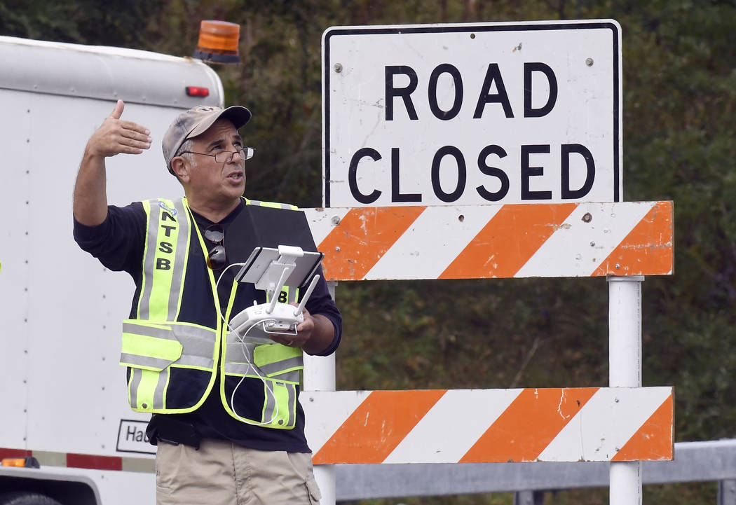 A drone operator with the National Transportation Safety Board conducts an investigation at the scene of Saturday's fatal limousine crash in Schoharie, N.Y., Monday, Oct. 8, 2018. A limousine load ...