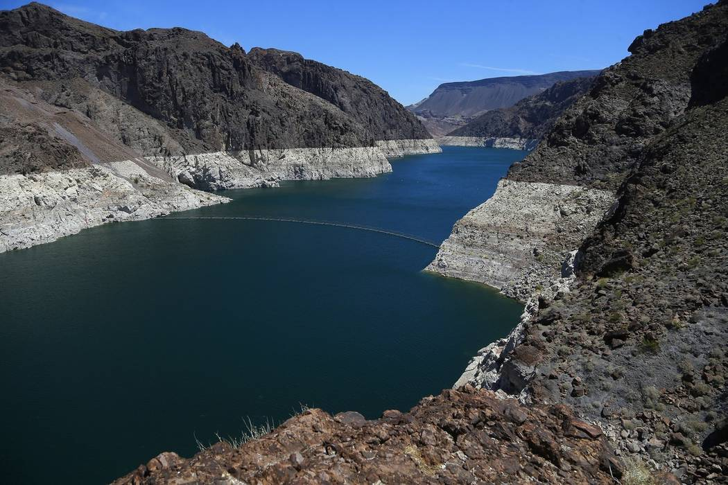 The low level of the water line is shown on the banks of the Colorado River near the Hoover Dam on May 31, 2018. (AP Photo/Ross D. Franklin)