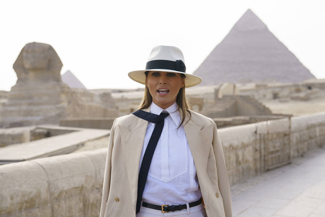 U.S. first lady Melania Trump talks to media as she visits the ancient statue of Sphinx, with the body of a lion and a human head, at the historic Giza Pyramids site near Cairo, Egypt on Saturday, ...