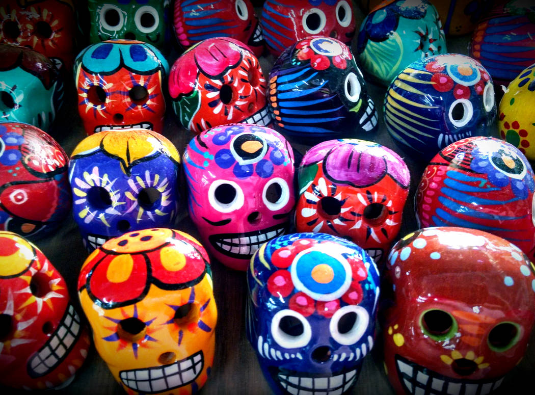 Rows of brightly colored Day Of The Dead skulls