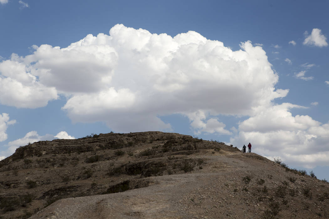 People hike to Exploration Peak in southwest Las Vegas. (Patrick Connolly/Las Vegas Review-Journal) @PConnPie