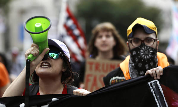 Demonstrators protest before a speech by President Donald Trump at the National Electrical Contractors Convention, Tuesday, Oct. 2, 2018, in Philadelphia. (AP Photo/Matt Slocum)