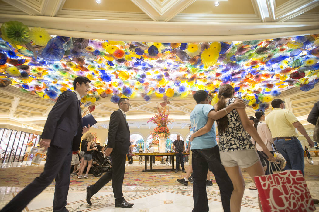 Patrons pass by the Chihuly Fiori de Como glass sculpture in the lobby of Bellagio on Tuesday, Oct. 2, 2018, in Las Vegas. Benjamin Hager Las Vegas Review-Journal @benjaminhphoto