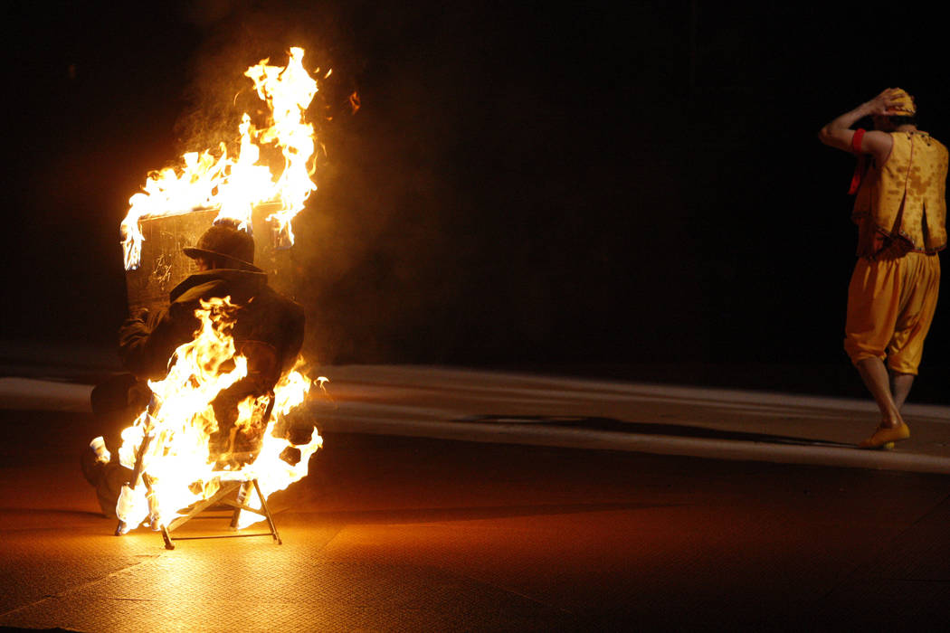 "Ray Wold burns as he reads a newspaper during a fire dancer's act in ""O"" at the Bellagio Thursday, May 12, 2011. ""O"", which started with the opening of Bellagio in 1998, is marking its 6,000th sho ..."