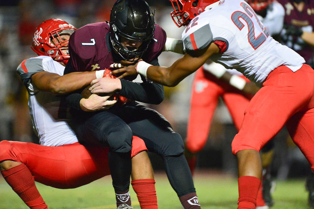 Faith Lutheran's Sagan Gronauer (7) is brought down by Arbor View's Billy Davis (15) and Zavier Alston (22) in the first half at Faith Lutheran in Las Vegas on Friday, Oct. 5, 2018. Arbor View lea ...