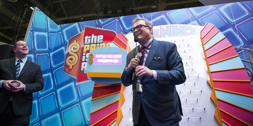 Dallas Orchard, IGT Chief Product Officer, left, watches as entertainment icon and famed gameshow host Drew Carey leads the world debut of three IGT Price is Right slot games at the 18th annual Gl ...