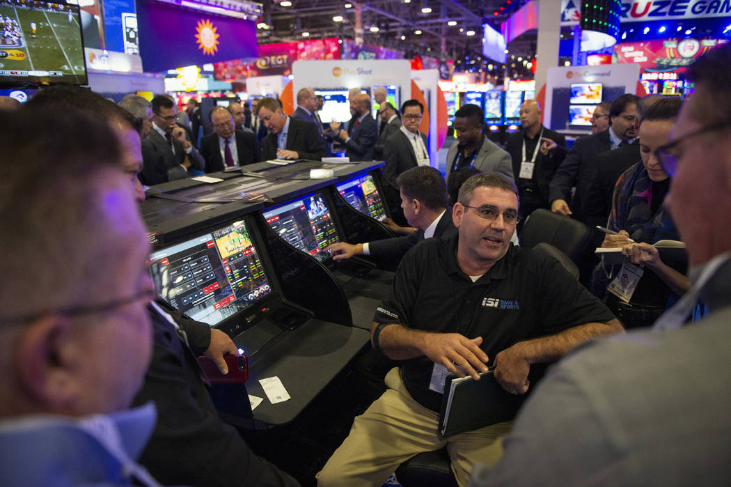 James Brooks from IGT explains to a group of attendees the IGT Crystal Betting System at the 18th annual Global Gaming Expo at Sands Expo and Convention Center in Las Vegas, Wednesday, Oct. 10, 20 ...
