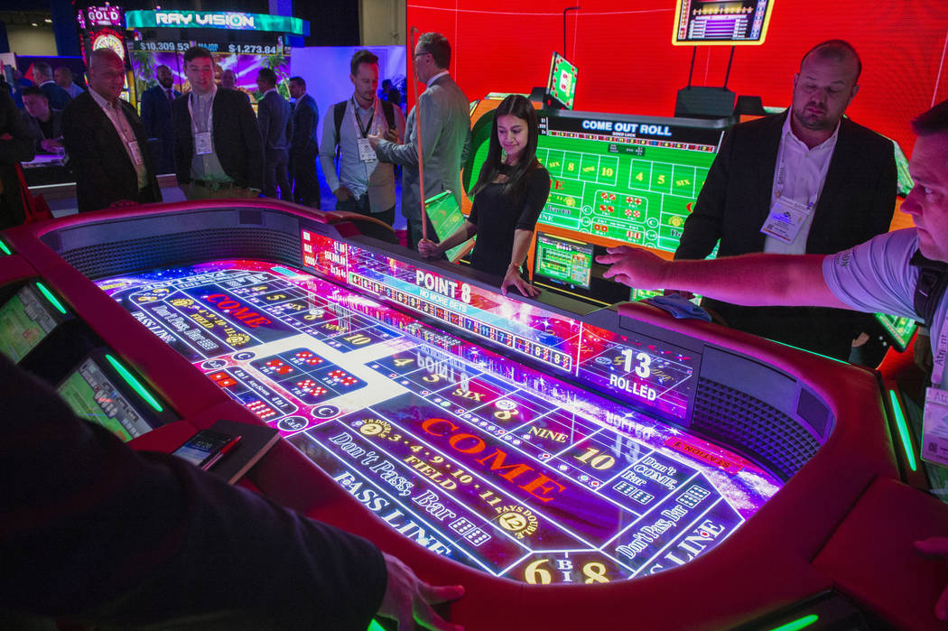 Aruze Gaming showcases its new electronic craps table at the 18th annual Global Gaming Expo at Sands Expo and Convention Center in Las Vegas, Wednesday, Oct. 10, 2018. Caroline Brehman/Las Vegas R ...