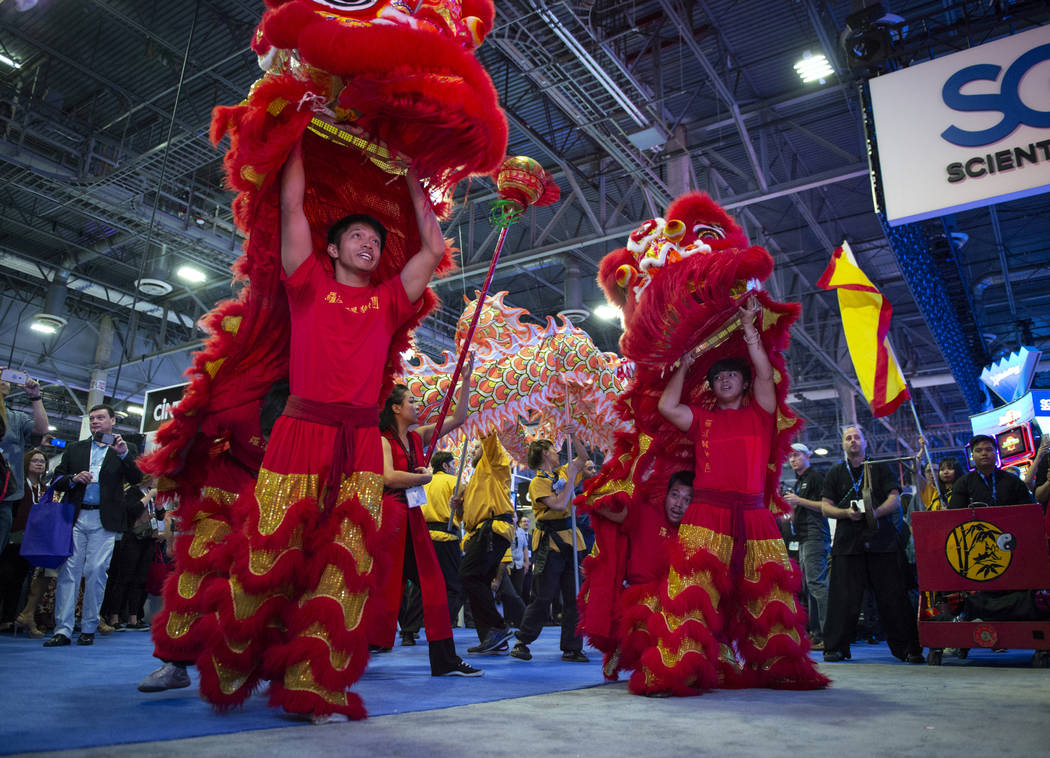 Members from the Lohan School of Shaolin in China Town perform at the Aristocrat booth for the attendees at the 18th annual Global Gaming Expo at Sands Expo and Convention Center in Las Vegas, Wed ...