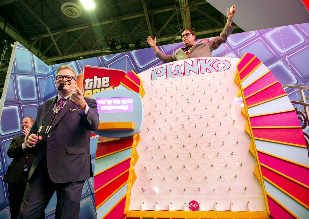 Entertainment icon and famed gameshow host Drew Carey plays Plinko with the National Indian Gaming Association Chairman Ernie Stevens Jr. at the 18th annual Global Gaming Expo at Sands Expo and C ...