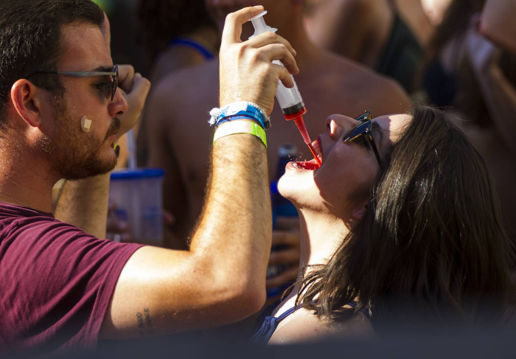 A shot syringe is one of many alcoholic options available at the Rehab dayclub at Hard Rock Hotel in Las Vegas on Saturday, June 24, 2017. Chase Stevens Las Vegas Review-Journal @csstevensphoto