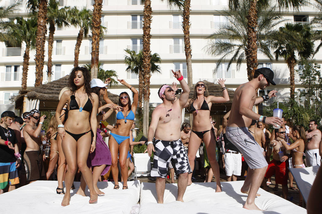 DUANE PROKOP/ REVIEW-JOURNAL Pool goers enjoy the warm weather at Rehab pool party located at Hard Rock hotel-casino , April 19, 2010 in Las Vegas, Nevada. Duane Prokop DUANE PROKOP/ REVIEW ...