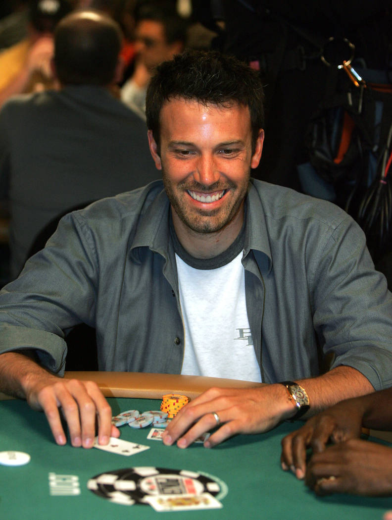 Actor Ben Affleck smiles after getting crushed on a hand of poker during the inaugural Ante Up For Africa Poker Tournament made up of celebrities and poker professionals at the World Series of Pok ...