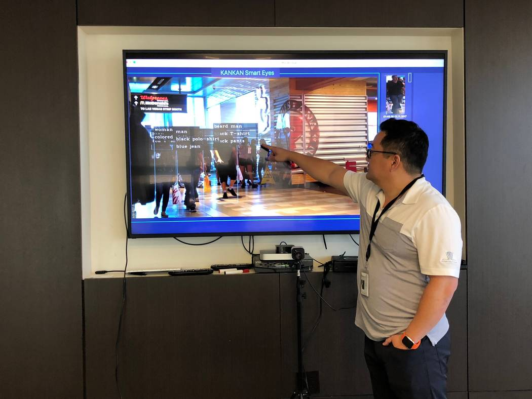 Shing Tao, CEO of Remake Holdings, shows off his facial recognition product applied to video shot on the Strip. (Todd Prince/Review-Journal)