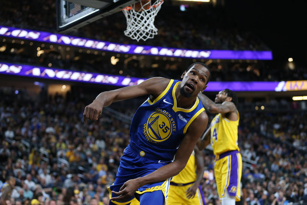 Golden State Warriors forward Kevin Durant (35) makes a shot against the Los Angeles Lakers in the NBA game at T-Mobile Arena in Las Vegas, Wednesday, Oct. 10, 2018. Erik Verduzco Las Vegas Review ...