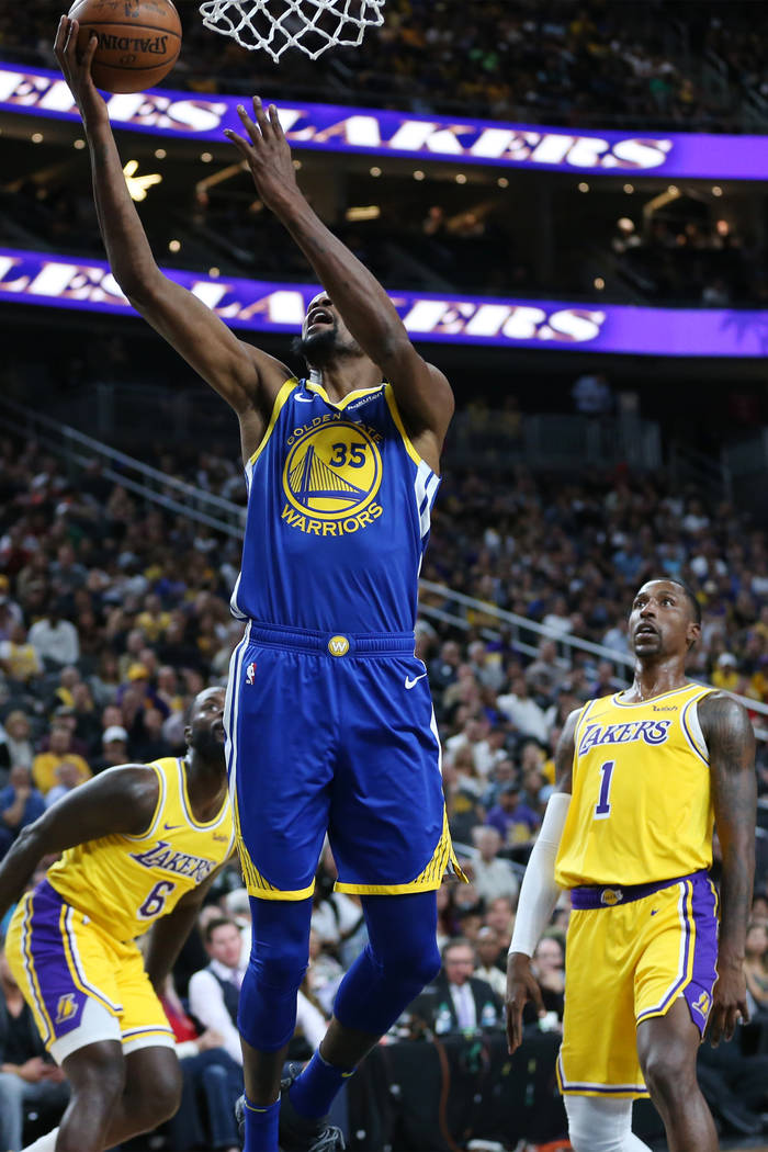 Golden State Warriors forward Kevin Durant (35) goes up for a shot against the Los Angeles Lakers in the NBA game at T-Mobile Arena in Las Vegas, Wednesday, Oct. 10, 2018. Erik Verduzco Las Vegas ...
