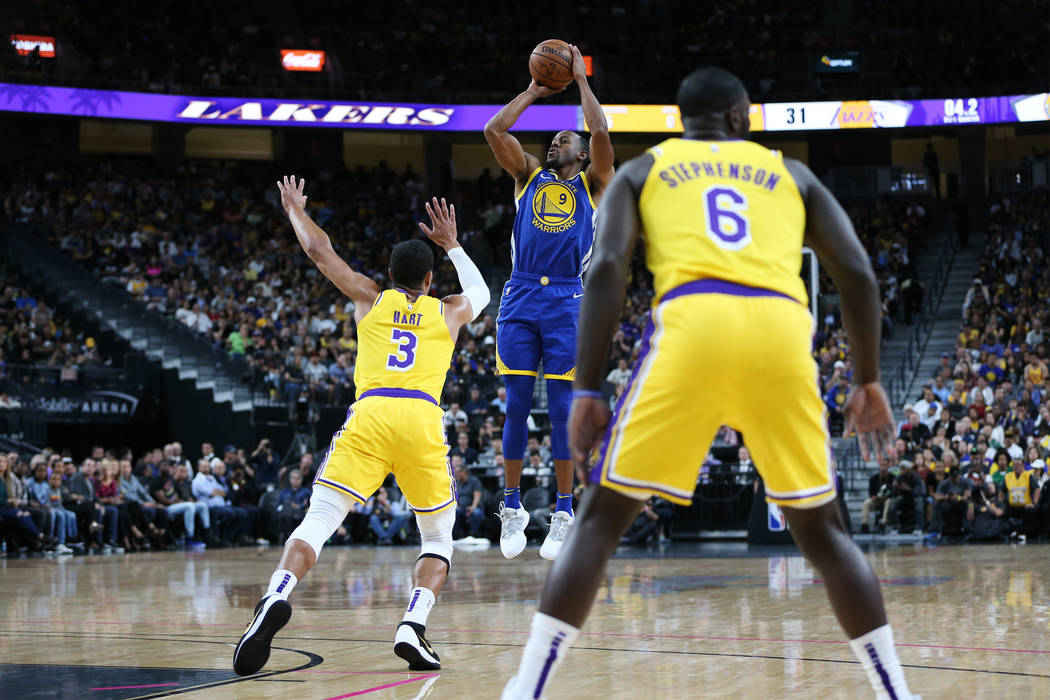 Golden State Warriors guard Andre Iguodala (9) goes up for a shot against Los Angeles Lakers guard Josh Hart (3) in the NBA game at T-Mobile Arena in Las Vegas, Wednesday, Oct. 10, 2018. Erik Verd ...
