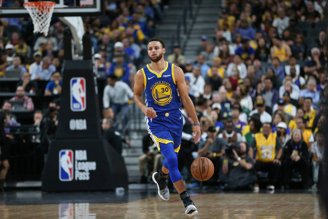 Golden State Warriors guard Stephen Curry (30) walks the ball up the court against the Los Angeles Lakers in the NBA game at T-Mobile Arena in Las Vegas, Wednesday, Oct. 10, 2018. Erik Verduzco La ...