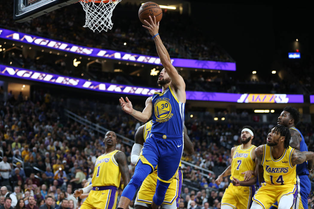 Golden State Warriors guard Stephen Curry (30) goes up for a shot against the Los Angeles Lakers in the NBA game at T-Mobile Arena in Las Vegas, Wednesday, Oct. 10, 2018. Erik Verduzco Las Vegas R ...