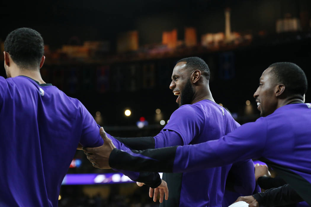 Los Angeles Lakers forward LeBron James (23), center, reacts with his teammates after a score by a team during their NBA preseason game against the Golden State Warriors at T-Mobile Arena in Las V ...