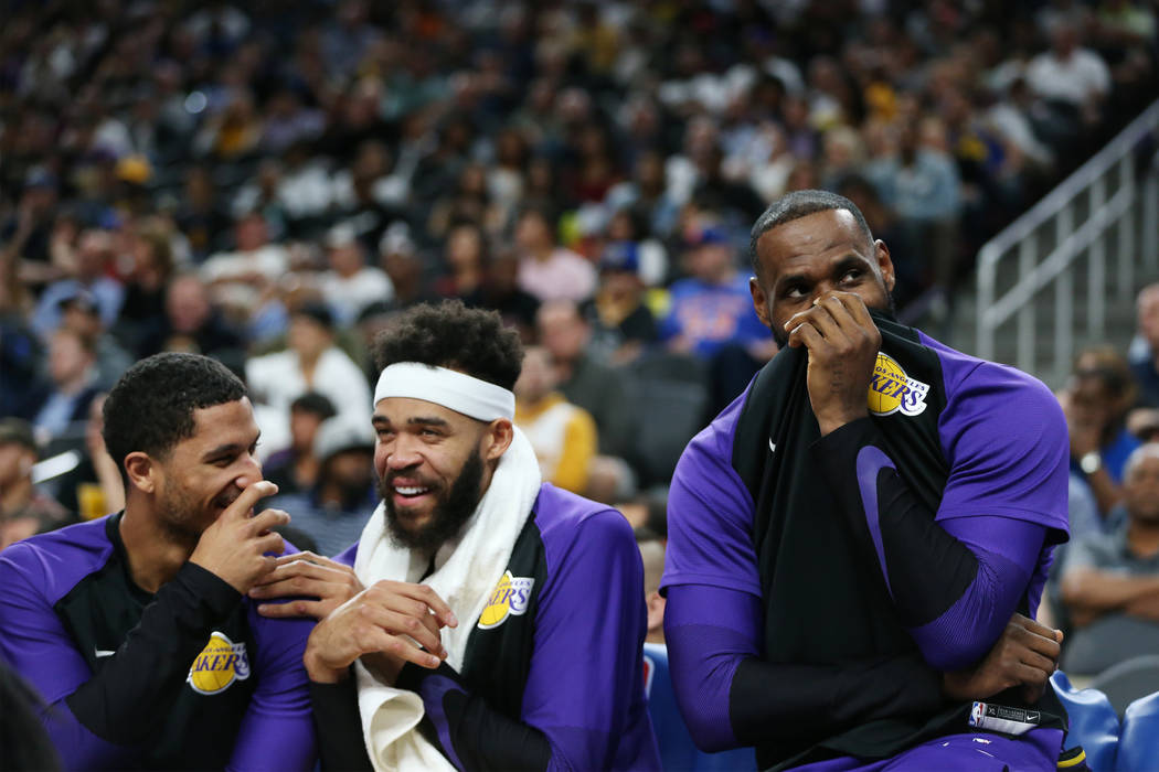 Los Angeles Lakers guard Josh Hart (3) from left, center JaVale McGee (7) and forward LeBron James (23) share a laugh on the bench during their NBA preseason game against the Golden State Warriors ...