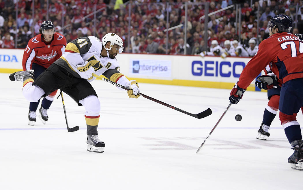 Vegas Golden Knights left wing Pierre-Edouard Bellemare (41), of France, shoots against Washington Capitals defenseman John Carlson (74) during the first period of an NHL hockey game Wednesday, Oc ...