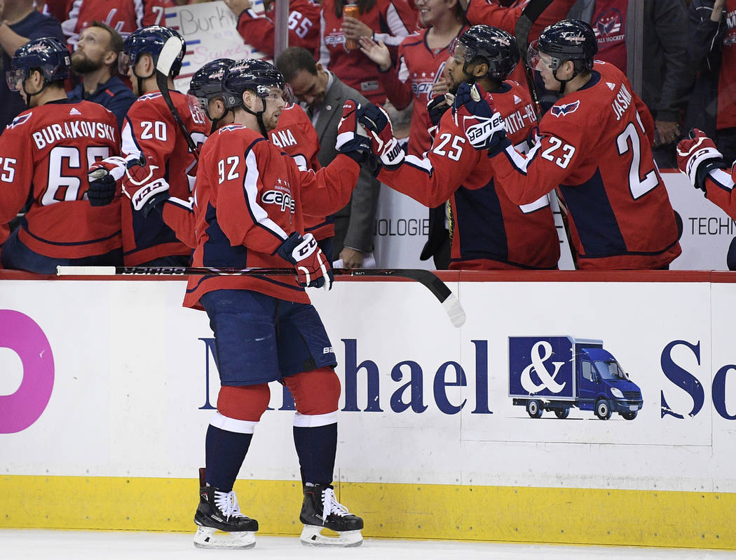 Washington Capitals center Evgeny Kuznetsov (92), of Russia, celebrates his goal with teammates on the bench during the first period of an NHL hockey game against the Vegas Golden Knights, Wednesd ...