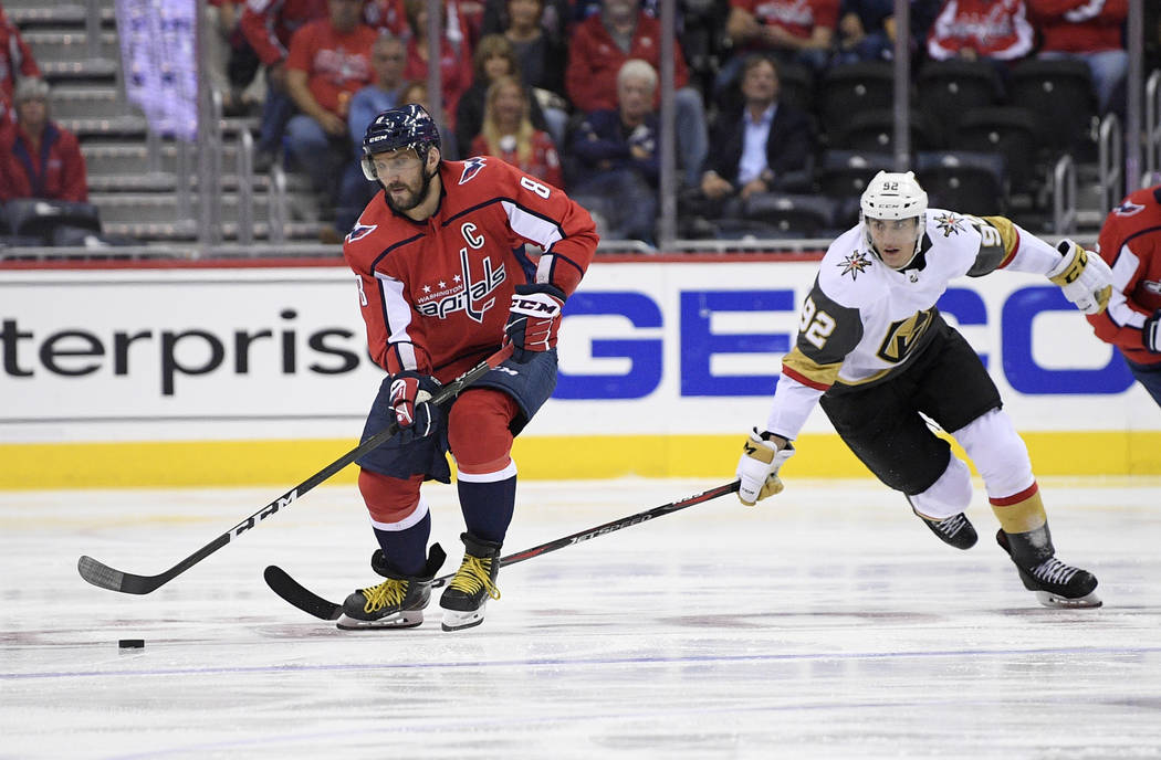 Washington Capitals left wing Alex Ovechkin (8), of Russia, skates with the puck against Vegas Golden Knights left wing Tomas Nosek (92) during the second period of an NHL hockey game Wednesday, O ...