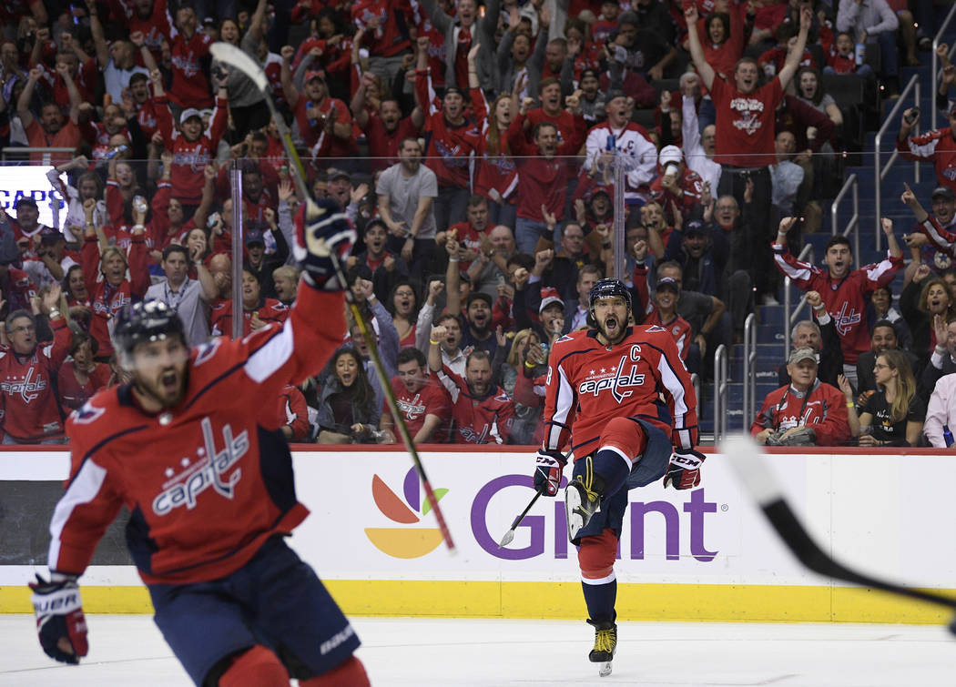 Washington Capitals left wing Alex Ovechkin (8), of Russia, celebrates his goal during the second period of an NHL hockey game against the Vegas Golden Knights, Wednesday, Oct. 10, 2018, in Washin ...