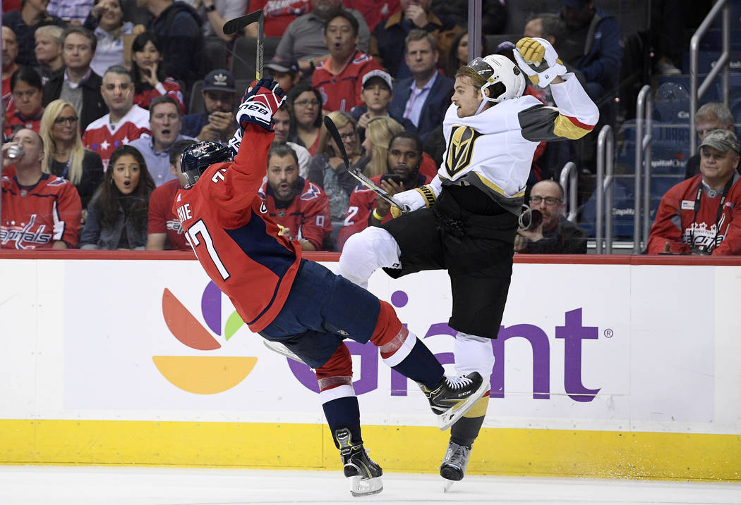 Washington Capitals right wing T.J. Oshie, left, collides with Vegas Golden Knights defenseman Jon Merrill during the second period of an NHL hockey game Wednesday, Oct. 10, 2018, in Washington. ( ...