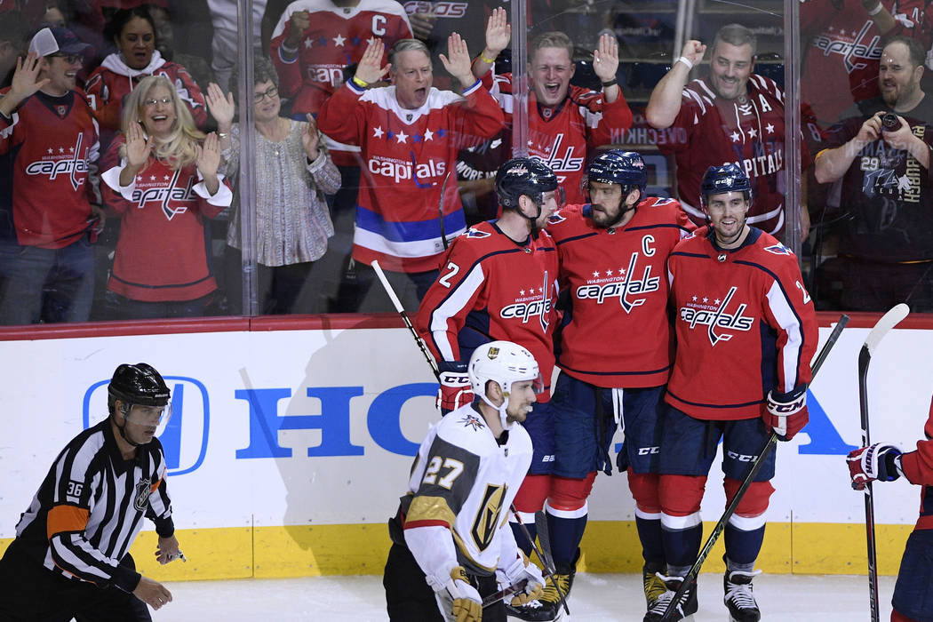 Washington Capitals left wing Alex Ovechkin, top center, of Russia, celebrates his goal with Matt Niskanen, top right, and Evgeny Kuznetsov, of Russia, during the third period of an NHL hockey gam ...