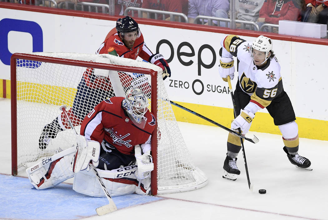 Vegas Golden Knights left wing Erik Haula (56) skates with the puck next to Washington Capitals defenseman Brooks Orpik (44) and goaltender Braden Holtby (70) during the third period of an NHL hoc ...