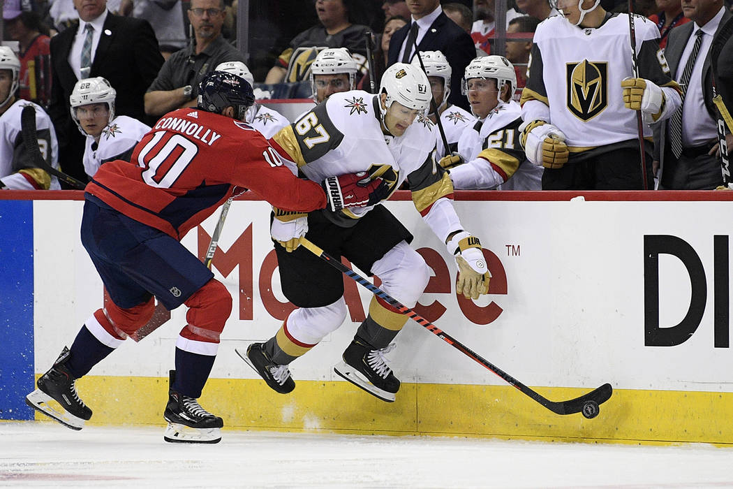 Vegas Golden Knights left wing Max Pacioretty (67) chases the puck against Washington Capitals right wing Brett Connolly (10) during the first period of an NHL hockey game Wednesday, Oct. 10, 2018 ...