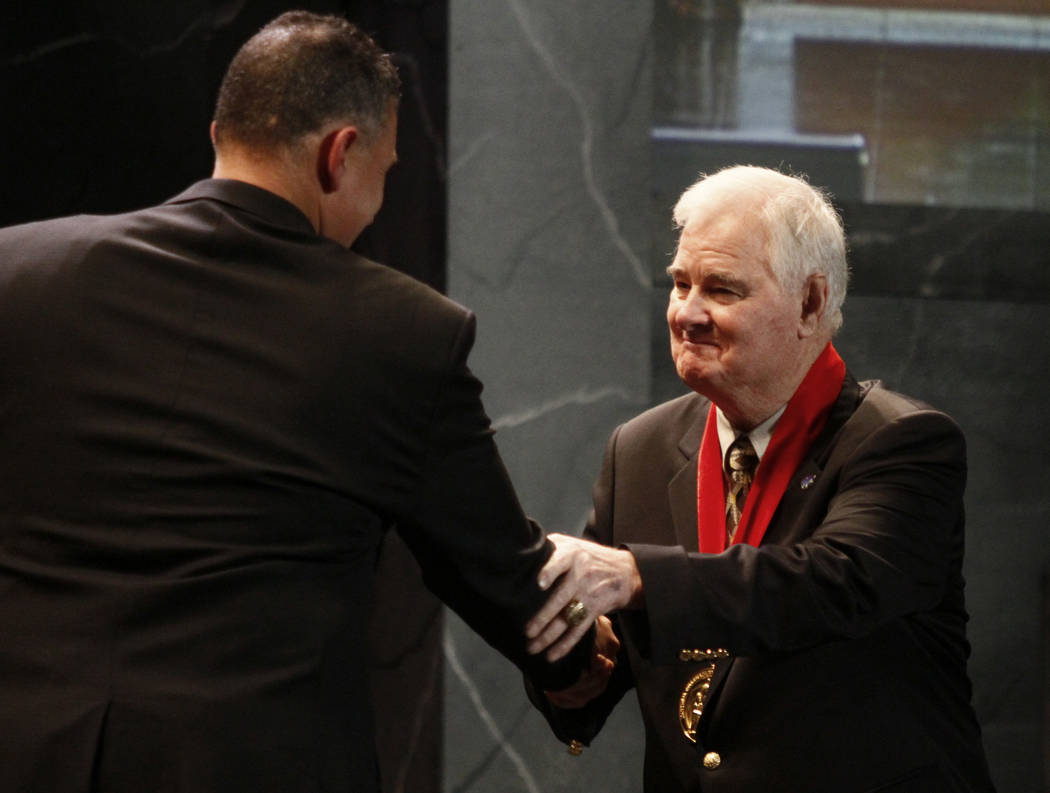 Former Kansas State basketball coach Tex Winter, right, shakes hands with Kansas State coach Frank Martin during the former's induction into the National Collegiate Basketball Hall of Fame in Kans ...