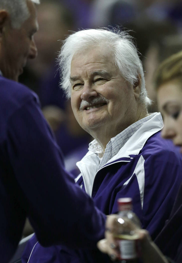 Former Kansas State basketball coach Tex Winter smiles when greeted in the crowd during the first half of the team's NCAA college basketball game against Oklahoma State in Manhattan, Kan., on Jan. ...