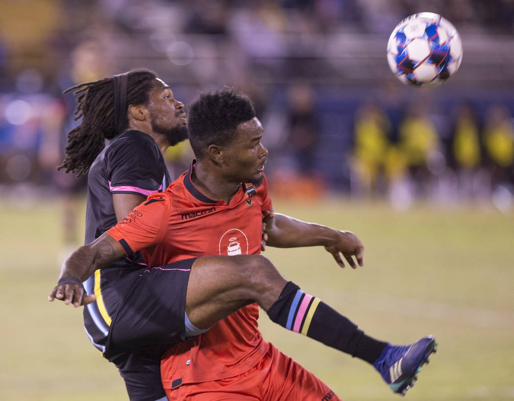 Las Vegas Lights defender Carter Manley (2) fights for possession with Phoenix Rising forward Kevaughn Frater (51) in the first half on Wednesday, Oct. 10, 2018, at Cashman Field, in Las Vegas. Be ...
