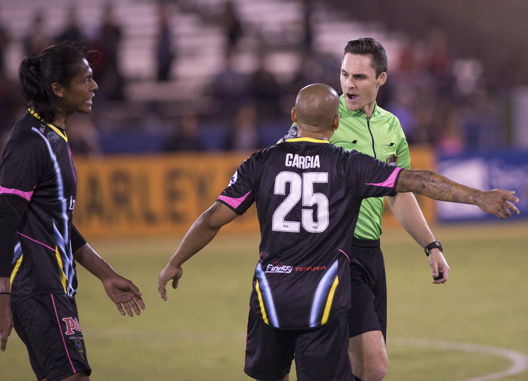 Las Vegas Lights FC midfielder Rafael García (25) argues a call with the referee in the first half during their United Soccer League game with the Phoenix Rising on Wednesday, Oct. 10, 2018, ...