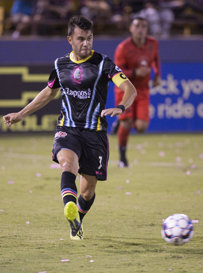 Las Vegas Lights FC midfielder Carlos Alvarez (7) pushes the ball up field during their United Soccer League game with the Phoenix Rising on Wednesday, Oct. 10, 2018, at Cashman Field, in Las Vega ...