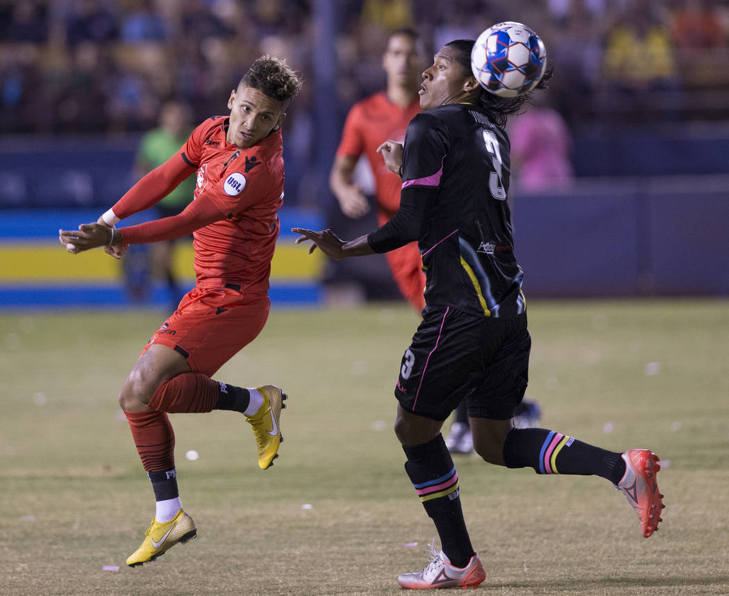 Las Vegas Lights FC defender Joel Huiqui (3) fights for possession with Phoenix Rising midfielder Devin Vega (23) in the first half on Wednesday, Oct. 10, 2018, at Cashman Field, in Las Vegas. Ben ...