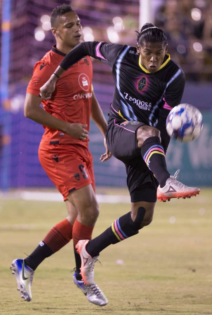 Las Vegas Lights FC defender Joel Huiqui (3) clears a ball past Phoenix Rising forward Chris Cortez (9) in the first half on Wednesday, Oct. 10, 2018, at Cashman Field, in Las Vegas. Benjamin Hage ...