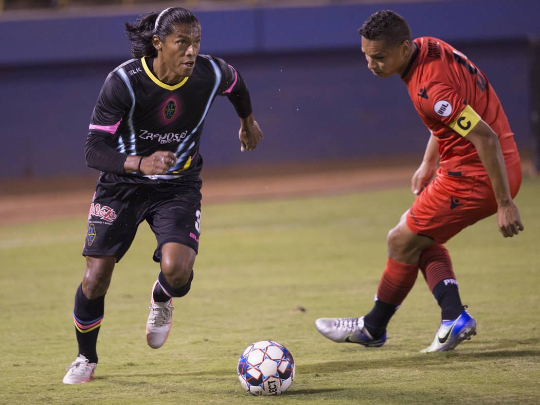 Las Vegas Lights FC defender Joel Huiqui (3) sprints past Phoenix Rising forward Chris Cortez (9) in the first half on Wednesday, Oct. 10, 2018, at Cashman Field, in Las Vegas. Benjamin Hager La ...