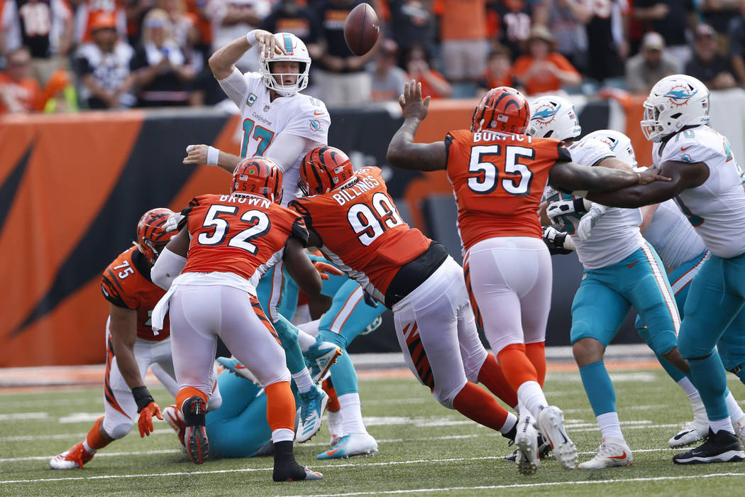 In this Oct. 7, 2018, file photo, Miami Dolphins quarterback Ryan Tannehill (17) throws an interception that was returned for a touchdown during the second half of an NFL football game against the ...