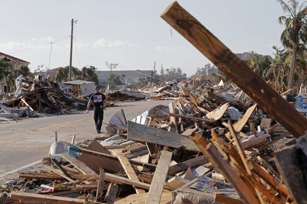 Logan Brisson of the Sarasota County Fire Dept. strike team, walks past debris in the aftermath of Hurricane Michael in Mexico Beach, Fla., Thursday, Oct. 11, 2018. The devastation inflicted by Hu ...