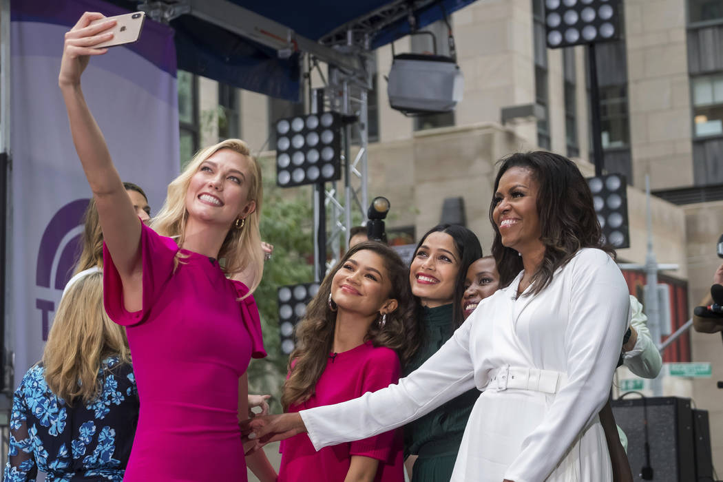 "Karlie Kloss, from left, Zendaya, Freida Pinto, Monica Nyiraguhabwa and Michelle Obama participate in the International Day of the Girl on NBC's ""Today"" show at Rockefeller Plaza on Thur ..."
