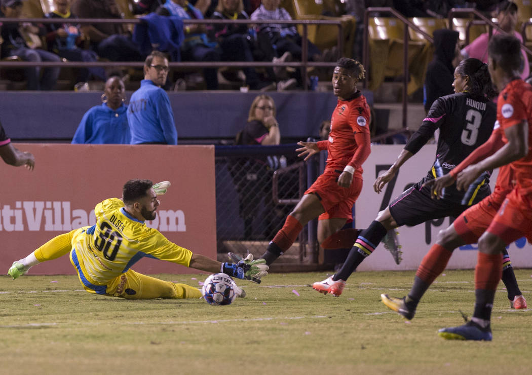 Las Vegas FC goalkeeper Thomas Olsen (30) makes a save with the help of defender Joel Huiqui (3) in the first half during their United Soccer League game with the Phoenix Rising on Wednesday, Oct. ...