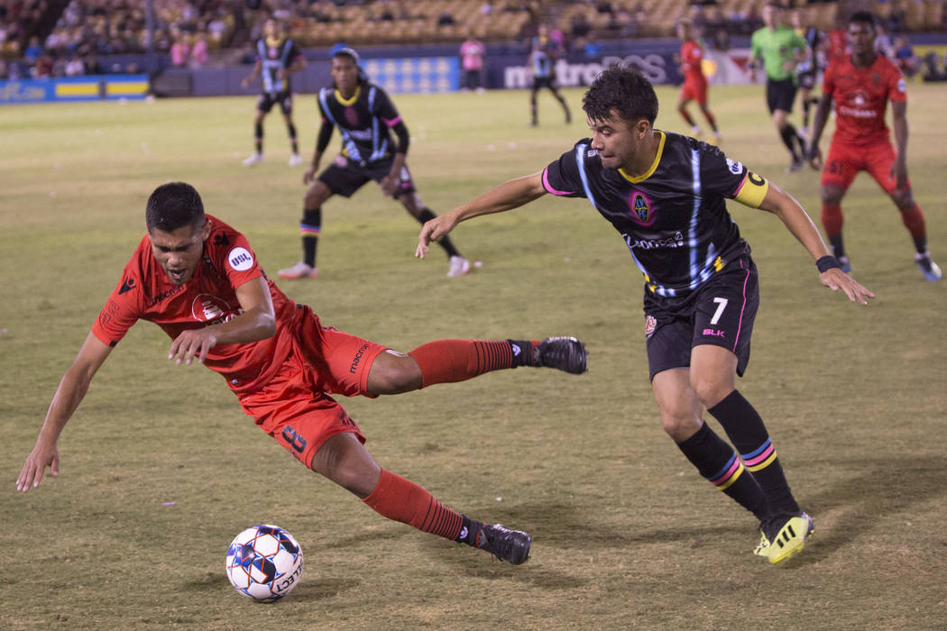 Las Vegas Lights FC midfielder Carlos Alvarez (7) collides with Phoenix Rising midfielder Collin Fernandez (8) in the first half on Wednesday, Oct. 10, 2018, at Cashman Field, in Las Vegas. Benjam ...
