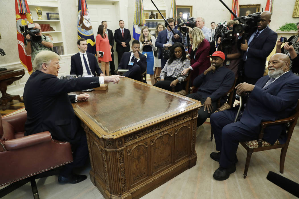 President Donald Trump talks to NFL Hall of Fame football player Jim Brown, seated right, and Rapper Kanye West, seated center, and others in the Oval Office of the White House, Thursday, Oct. 11, ...