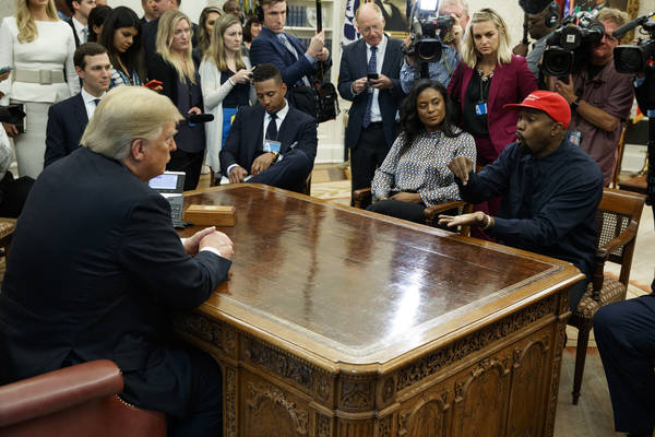 Rapper Kanye West speaks during a meeting with President Donald Trump in the Oval Office of the White House, Thursday, Oct. 11, 2018, in Washington. At left is White House Senior Adviser Jared Kus ...